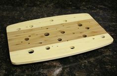 DIY cooling rack. drill holes in a wooden cutting board, glue 4 small 'feet' and you have your very own cooling rack