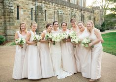Champagne Alfred Sung bridesmaid dresses.