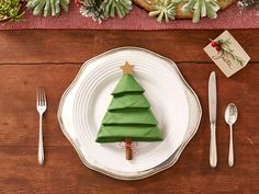 Christmas Tree Napkins. Get ready to impress your holiday dinner guests with this easy DIY from Publix.