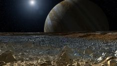 This artist's concept shows a simulated view from the surface of Jupiter's moon Europa. Europa's potentially rough, icy surface, tinged with reddish areas that scientists hope to learn more about, can be seen in the foreground. The giant planet Jupiter looms over the horizon.
