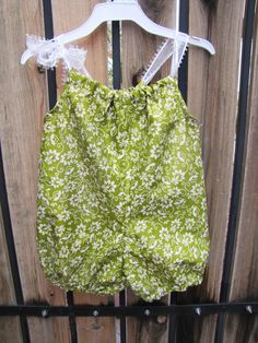 A personal favorite from my Etsy shop https://www.etsy.com/listing/220839894/ready-to-ship-light-floral-green-romper
