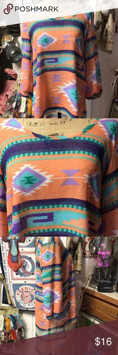 Daytrip hi/low tribal print top or swimsuit cover This is so precious with great colors. In like new condition! Sheer, so would look great with a coordinating tank underneath, or awesome over a black swimsuit. Very flowing and comfortable. No size tag, but fits like a L. daytrip Tops Tunics