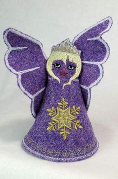 Designed and created totally in house. Their free standing design allows the Fairies to be an all year round ornament. Each one is created using machine embroidery and then hand finished. The fairies can be purchased from the range shown or made to order to customer specifications of tweed, hair, eye and embellishment colours. Clan tartans have proved to be particularly popular. Tweed – Lilac Hair – Blonde Eye – Blue Embellishment – Gold Email – info@thehebrideandesigncompany.com