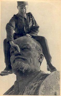 German Soldier on Lenin Statue by  Unknown Artist