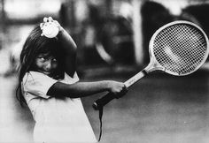 Photographer/Creator  Bill Strode  Collection  1967  Publisher  Courier-Journal & Louisville Times  Caption/Description  Picture of a young girl trying to hit a tennis ball with a racket that is too big for her.