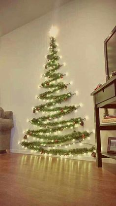 Easy Christmas Decor From simple to amazing Notable tips and tricks to form a fun and charming simple christmas decor diy xmas trees . Xmas image provided on this day 20190114 , exciting post reference 3707337813 Wall Christmas Tree, Noel Christmas, Diy Christmas Wall Decor, Xmas Trees, Tinsel Tree, Outdoor Christmas, Christmas Projects, Christmas Tree Made Of Lights, Christmas Tree Simple