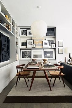 moody black and white apartment with monochromatic art display