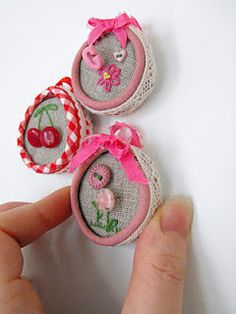 Mini embroidery hoops made with bottle tops.