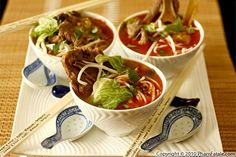 If you're familiar with phở, bún bò Huế is another beef rice noodle soup. The beef soup dish originated in the city of Huế, the old imperial capital of Vietnam. Like traditional phở bò, the broth of bún bò Huế is simmered with beef bones and Asian spices such as ginger, but the similarities pretty much end there. The real difference is that the broth is finished with lemongrass and red chiles.