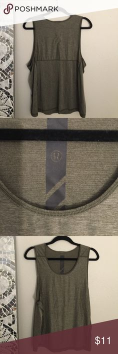 Army green loose Lululemon workout top Small to medium size Lululemon flowy army green workout top very light weight no support you need to wear a bra under but a great every day look lululemon athletica Tops Tank Tops