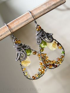 Amazing Earrings....get out your wire coiling gizmo pronto!
