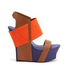 United Nude's Geisha is geared for accomplished and creative women who are not afraid to express their strength. With a lightweight platform wedge joined by bold leather and elastic straps, this Japanese inspired design topped of with color blocking, creates a joyful work of art. Geisha is definitely the height of self determination.  #shoes #unitednude