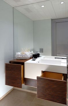 Bathroom :: Pitsou Kedem Architect. Offset drawers, counter to ceiling mirror, drawer front detailing.
