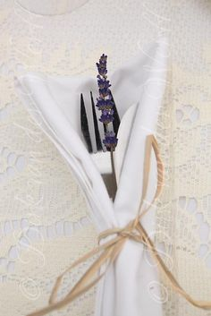 DELICATE LAVENDER NAPKIN DECORATION DETAIL AT  SALLY'S DANBY CASTLE WEDING IN YORKSHIRE, ENGLAND