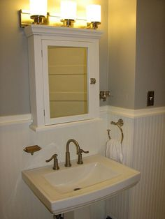 bathrooms with beadboard | We also used the standard 4 ft height in both of our bathrooms:   Also like the small cabinet