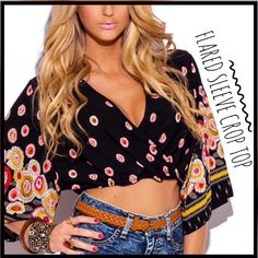 "Boho Sleeve Crop Top This cute boho flare sleeve crop top features: 100% rayon fabric which is not sheer, cross-over front, keyhole opening back, flared sleeves, and elasticized waist.                                 Measurements:                                                                        Large:  shoulder-16"", bust-15"", waist-14 1/2"", length-15 1/2"" Boutique Tops Crop Tops"