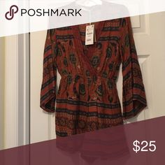 Bell sleeved romper with pockets! This lovely rust colored romper with pockets & bell sleeves! With a deep V-neck. Zara Other