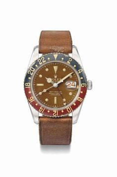 Rolex. A very fine and highly attractive stainless steel automatic dual time wristwatch with sweep centre seconds, alternate red and black date, tropical dial and bakelite bezel, circa 1958 #ChristiesWatches