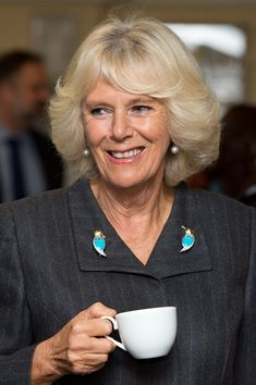 Camilla Duchess Of Cornwall meets staff during an official visit to HMP Erlestoke Prison on November 18, 2014 in Devizes, England.