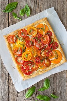 Tomato Recipes - Tomato, Goat Cheese, and Caramelized Onion Tart - Fresh tomatoes get baked in a flakey puff pastry shell with goat cheese and caramelized onions. Tart Recipes, Appetizer Recipes, Cooking Recipes, Recipes Dinner, Cooking Tips, Quiche Recipes, Spinach Recipes, Snacks Recipes, Greek Recipes