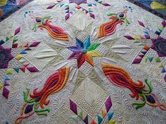 http://www.mainelyquiltsoflove.com--Love the colors in this quilt and the quilting is gorgeous.