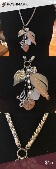 Guess necklace Cream & silver necklace with leather, feathers, crystals, wood & ivory hearts. Never worn. Jewelry Necklaces