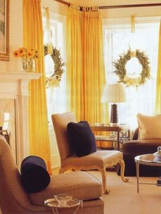 YELLOW COVERINGS with beachy window wreathes - love the wreaths for my living room windows