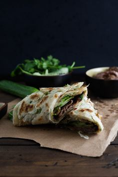 Chinese Beef Rolls - tender beef slices and greens wrapped in a flaky scallion pancake. via goodies a volonte