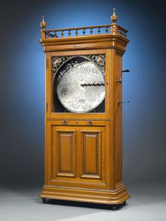 RARE coin-operated Regina Sublima upright music box crafted by the Regina Music Box Company