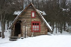 Ski cabin with red windows in Ushuaia, Argentina. Contributed by Deuscorreia.