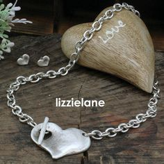 The DramaticDanon Chunky Silver Necklace With Chunky Heart Pendant from the celebrated designer brand is an instant hit here at Lizzielane. Featuring a striking concave medium size antique hammered silver heart design on a chunky silver link chain.