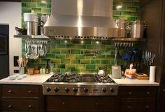 Green backsplash tile. Stainless Steel Appliances. Range hood.