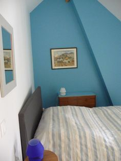 Tête de lit de la chambre double de couleur bleue