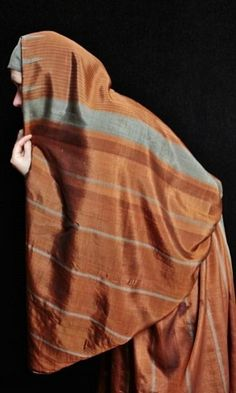 Late-Ottoman street-wear, from Aleppo (northern Syria), early 20th century.  Exported from there to many urban centers in Anatolia and the Levant.  Made of two large rectangular pieces of silk (ca. 110 x 210 cm), sewed together to form a baggy skirt and a kind of large airy cape.  The silk fabric is locally called 'meydaniye'.