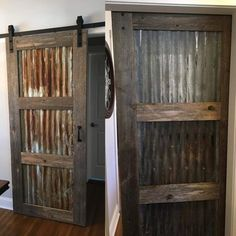 Sliding Barn Door Ideas - Andy came into Rustic Revival Barnwood and bought a door track, tin and boards and built this gorgeous rustic sliding barn door! Both sides of the door are stunning! Come in to shop for your DIY project or hire us! http://www.facebook.com/rusticrevivalbarnwood #reclaimed #rustic #barn #wood #rusticrevivalbarnwood #minnesota #slidingbarndoor