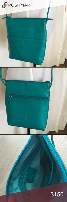 Ili New York Aqua Crossbody leather bag Gorgeous Spring color. Features outside and inside pocket. 100% Leather. Aqua Leather Crossbody Bag. Measures 8 X 9 X 2. Great color for Spring/Summer. Fully adjustable strap so you can wear at any length. Zippered outside pocket on front and two drop pockets on back Zippered pocket inside and zip top closure for security. ili New York Bags Crossbody Bags
