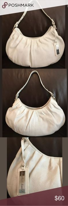 """Charles David Large Pebbled Leather Handbag I'm offering a beautiful Charles David Large White Pebbled Leather Hobo Shoulder Bag in Excellent condition, barely used, very clean in and out in quality thick Pebbled Leather.    It measures  18"""" x 10"""" x 3"""" and gas a thick Studded handle with an 11"""" drop.  The Handbag has double compartments with snap closures and zipper compartment in the middle.  It's lined in soft Microfiber suede, again very clean. Bags Shoulder Bags"""