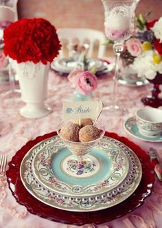 Such a pretty place setting by @POSH Couture Rentals, floral by Bridal Blooms, donut holes by Cupcake Bliss and design by Emily Clarke Photo by Sarah Kate