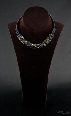 Vanity Rainbow - An elegant alternative to chokers and brimming with beauty. Featuring vibrant briolette crystals encased between captivating seed beads.