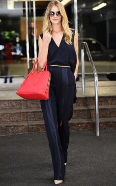 Trending Fashion Style: Jumpsuit. - Rosie Huntington Whiteley in front split detail sleeveless dark navy jumpsuit, L.A. street style October 2014.