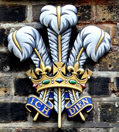 """London, Ede & Ravenscroft shop on Burlington Gardens, plaques with coats of arms of the Royal family, """"By Appointment to H. R. H. the Prince of Wales Robe Makers"""""""