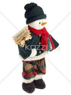 figurine in winter wear with billboard. - Figurine in winter wear with billboard against plain white background.