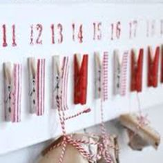 Advent Calendar (I could so do this: superglue, spray paint, wood, clothespins, scrapbook paper/wrapping paper, modge podge and glitter scrapbook numbers - may even find a nice Christian sticker to add and use natural wood I find behind my house in the country)!!