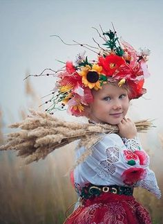 Ukraine - Naturally beautiful! This is one of my favourite photo captures of a Ukrainian child! She is wearing a sunflower and poppies in her hair - two national flower emblems of Ukraine along with the wheat upon her shoulder this says: Ukraine! Simply beautiful!