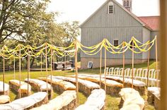 haybale seating for outdoor party - fab idea, have event then spread on garden! I need some mulch... Love the ribbons strung to form an aisle outdoors.