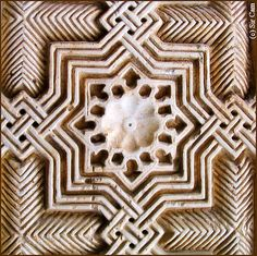 Granada, Spain. Detail of classic Islamic geometric patterns from The Alhambra. This is from the famous Court of the Lions, which has some of the most sophisticated geometric patterns in the world.  Photo by Sir Cam on Flickr.