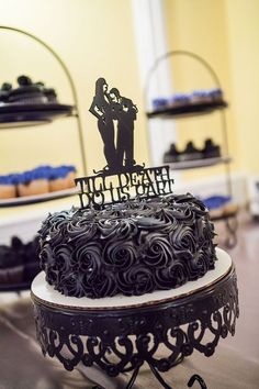 In love with this #morticiaandgomez wedding cake as seen on the @offbeatbride blog  #relationshipgoals #gothwedding #gothbride #addamsfamily