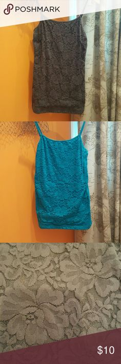 Blue and Grey tank tops Selling both together for $10. Purchased from Aeropostale. Grey one was worn once but the blue was never worn. Snug fit but very stretchy. Lace flower design on front. Without tags. Aeropostale Tops Tank Tops