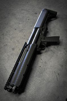 Kel Tec KSG Compact Shotgun.  i want I want I want!  Who loves me