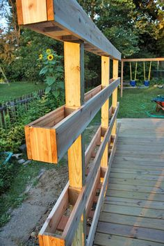 Free-standing DIY Vertical Garden Window Boxes - also acts as privacy screen.